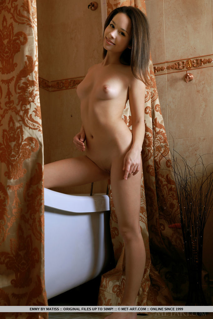 Emmy bares her nubile body on the tub as she takes a bath.