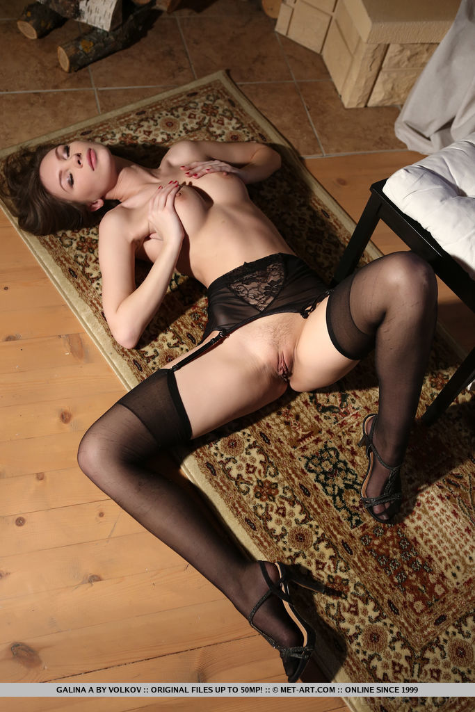 Galina A sensually strips her sexy lingerie baring her sexy body.
