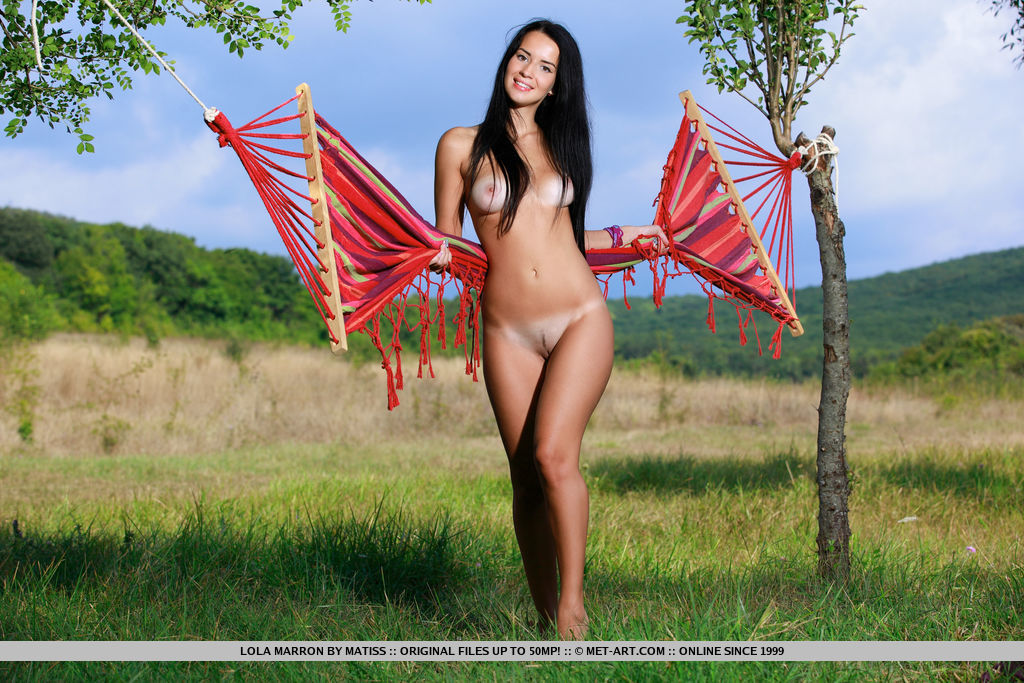 Lola Marron shows off her gorgeous tits with sexy tan lines as she poses outdoors.