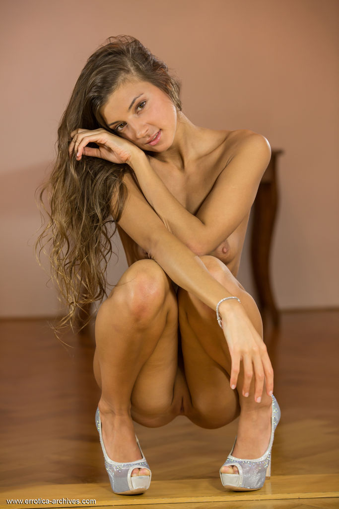 Melena A shows off her lusty body as she sensually poses in front of the camera.