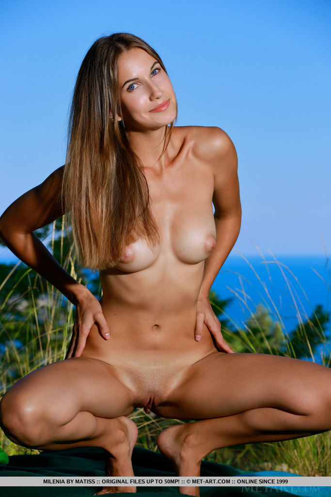 Milenia displays her sexy, tight body and yummy pussy by the lake.