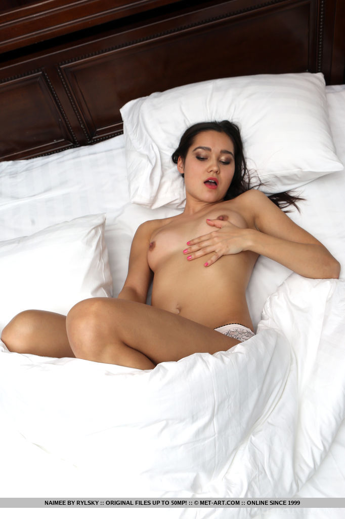 Naimee erotically poses on the bed baring her lusty body.