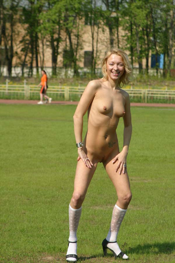 Naked blonde at university stadium