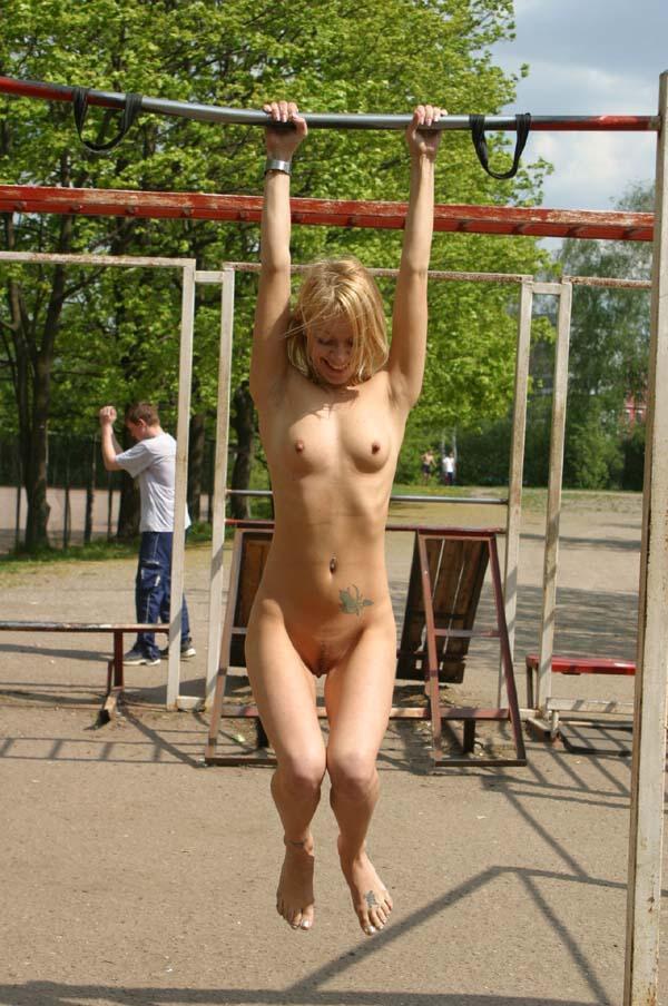 Naked blonde at university stadium