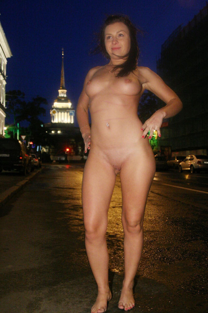 Naked brunette walking in the night city