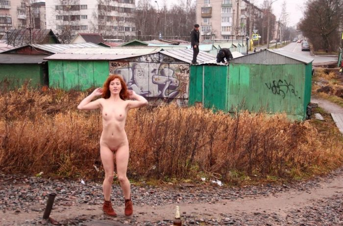Russian redhead posing naked on railway