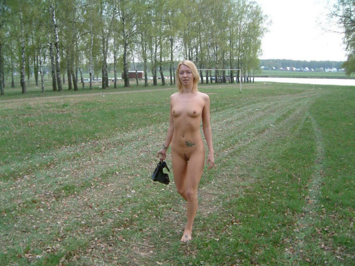 Tattooed blonde Loli in nature
