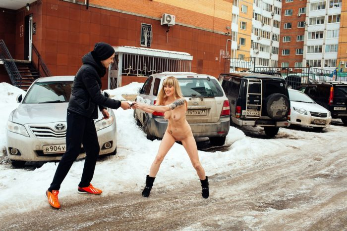 Tattooed blonde with realy good body at winter streets