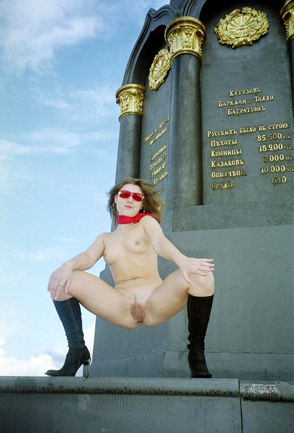 Teen girl Jella takes off panties near monument