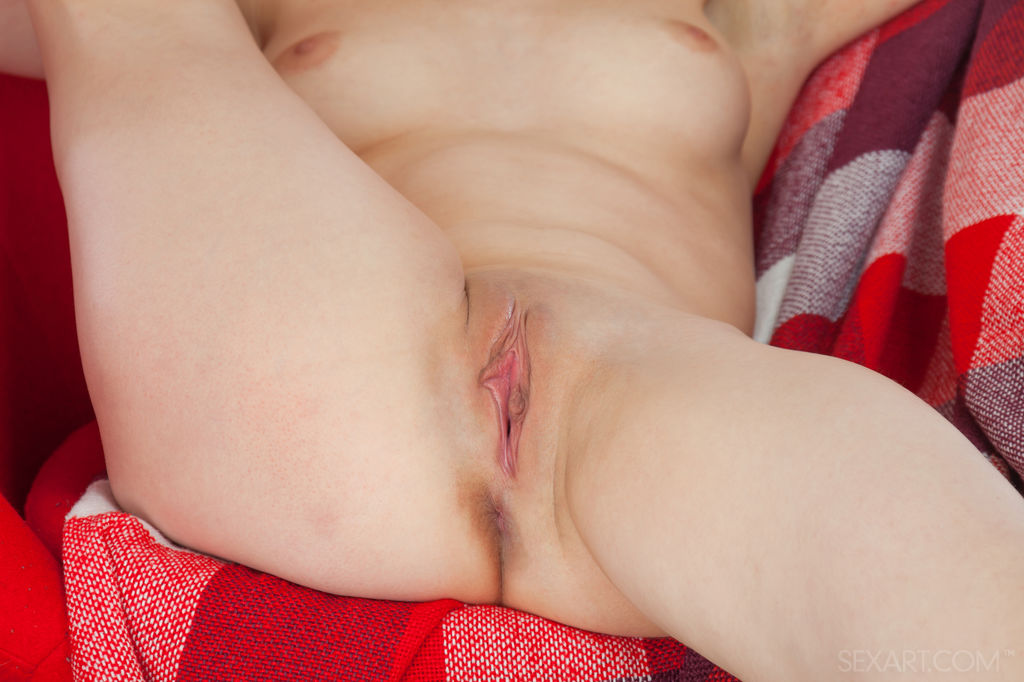 Winnie pleases her pink, shaved pussy with a fat, red dildo