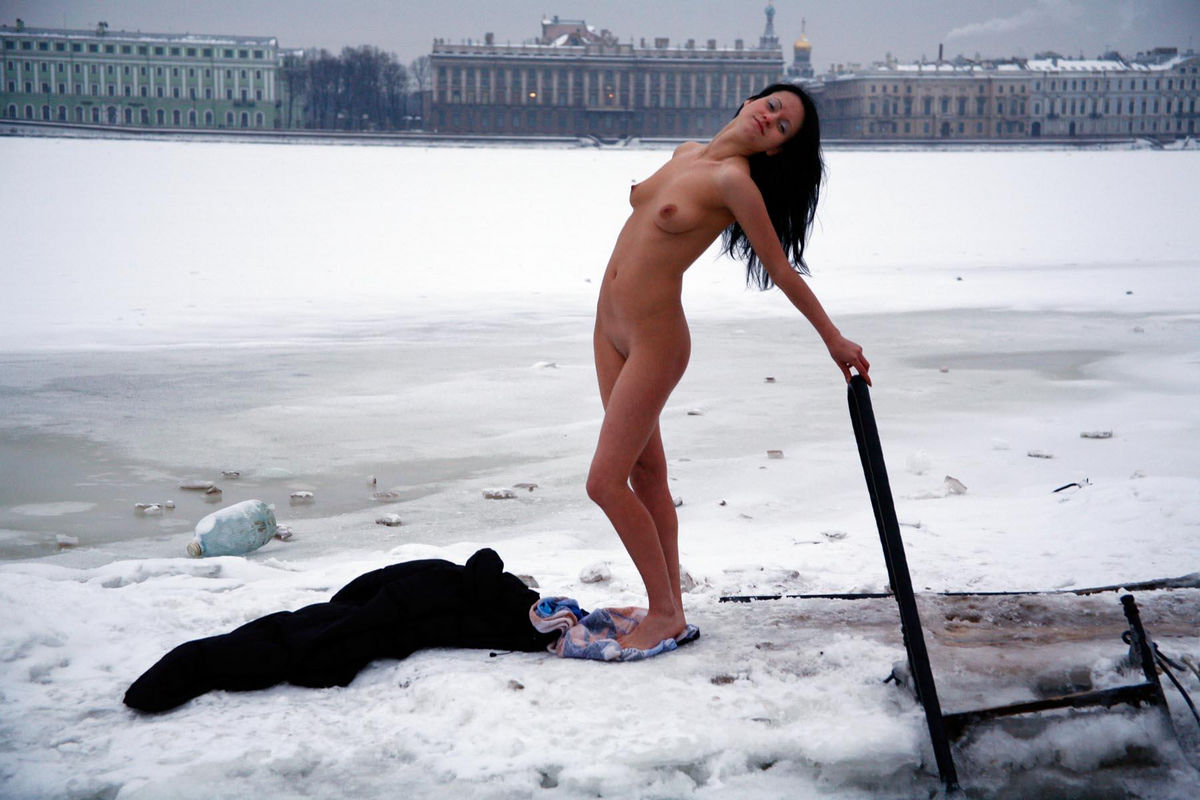 Young brunette wants to swim in an ice hole in winter ...
