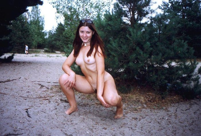 Young girl touches her hairy pussy at nudist beach
