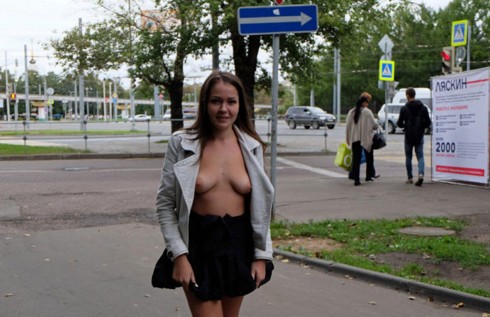 Yummy damsel in a mini skirt on the streets
