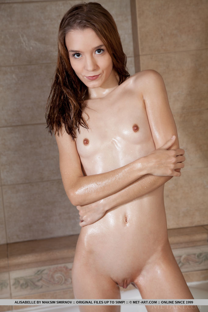 Alisabelle takes a dip on the tub as she takes a bath baring her petite body.