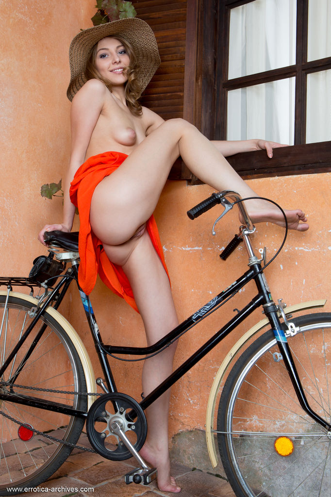 Alluring Nikia A bares her pink, puffy nipples and sweet pussy on the bike.