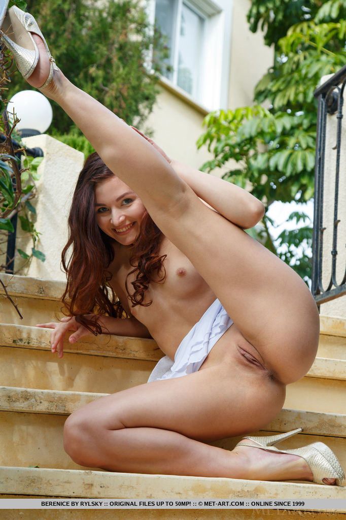 Berenice stpreads her legs wide open as she displays her sweet pussy outdoors.