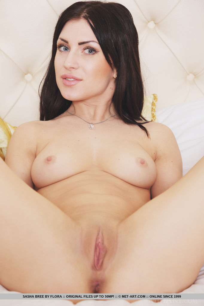 Dark-haired Sasha Bree looks lusciously tempting in a sheer white lingerie that shows off her beautify body curves