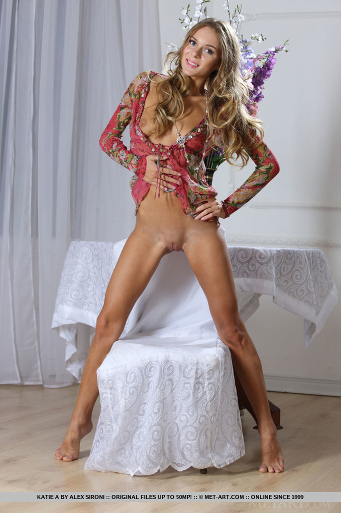 Elegant beauty Katie A loves showing off her slim and well-toned body with gorgeous, sun-kissed complexion.