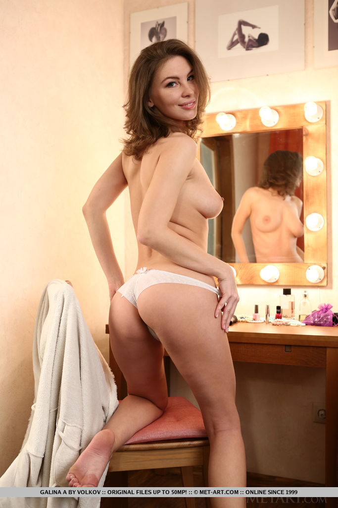 Galina A bares her amazing physique as she poses in the dressing room.