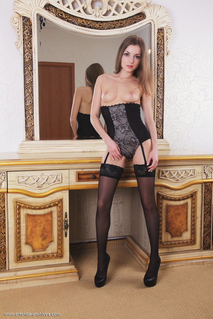 Giulia strips her sexy, black corset with matching stockings as she bares her sweet pussy.