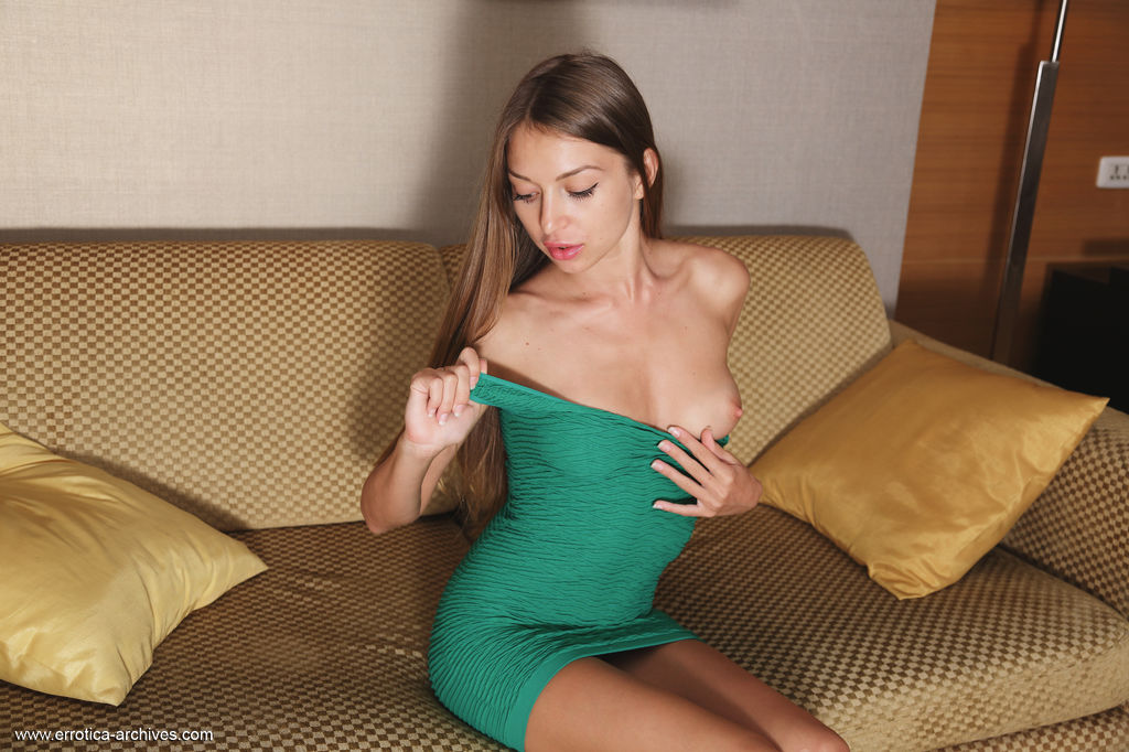 Leila Mazz strips her green dress as she bares her petite, tight body, tight ass and clean smooth pussy on the sofa.