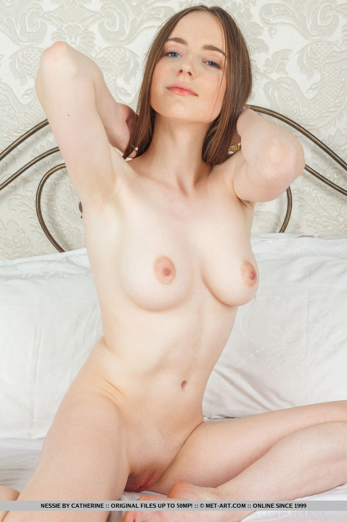 Nessie sensually poses on the bed as she flaunts her creamy, white body and pink pussy.