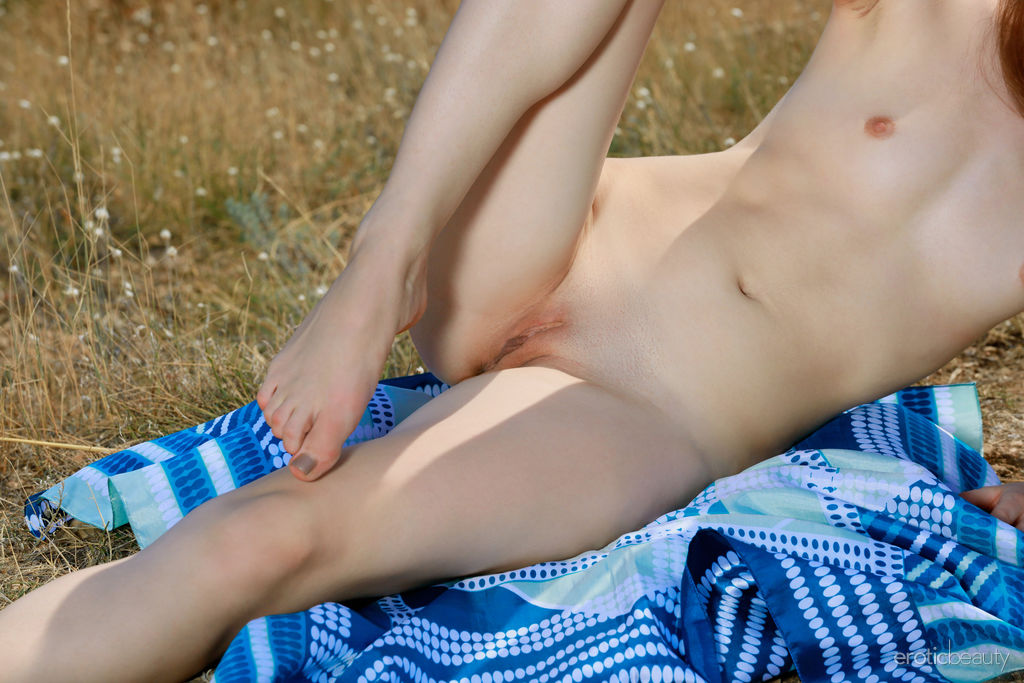 Newcomer Amila A sensually poses outdoors baring her nubile body.