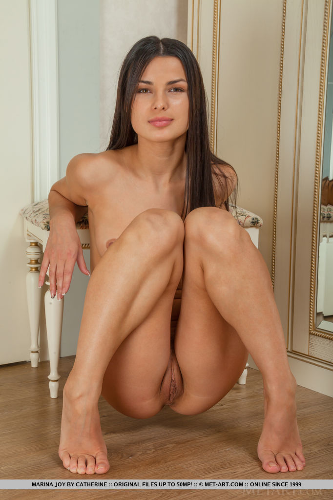 The gorgeous Marina Joy proudly showcasing her long and slender physique with smooth and tanned skin