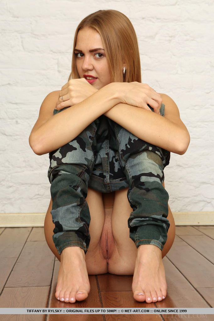 Tiffany playfully poses in her camo leggings before stripping naked to show off her slim physique.