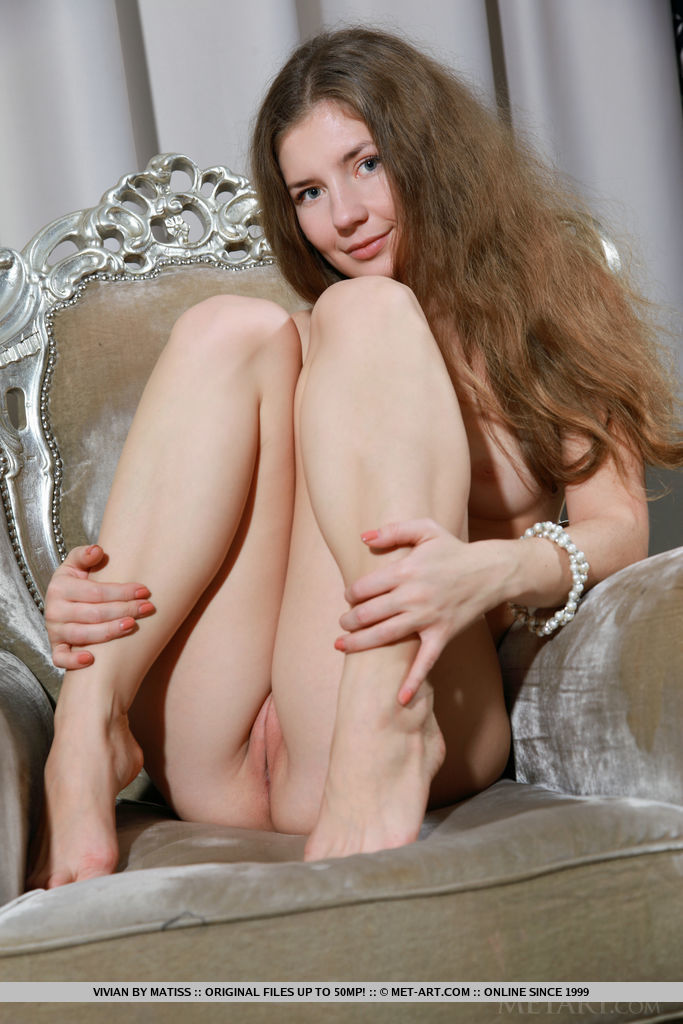 Vivian shows off her trimmed pussy and nubile body on the chair.