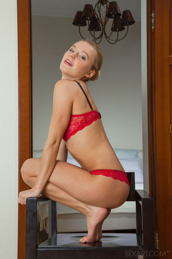 Xena strips off her matching red lace lingerie before satisfying her smooth pussy with a finger fuck