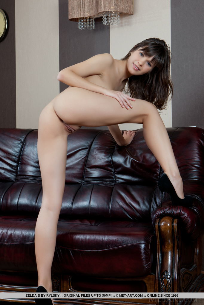 Zelda B shows off her delectable pussy as she strip on the sofa.