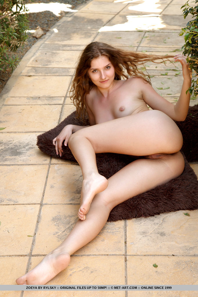 Zoeya bares her slender body and hairy pussy ass she poses on the pavement.