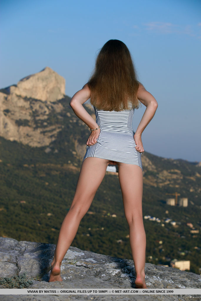 ivian shows off her tight ass and smooth body outdoors.