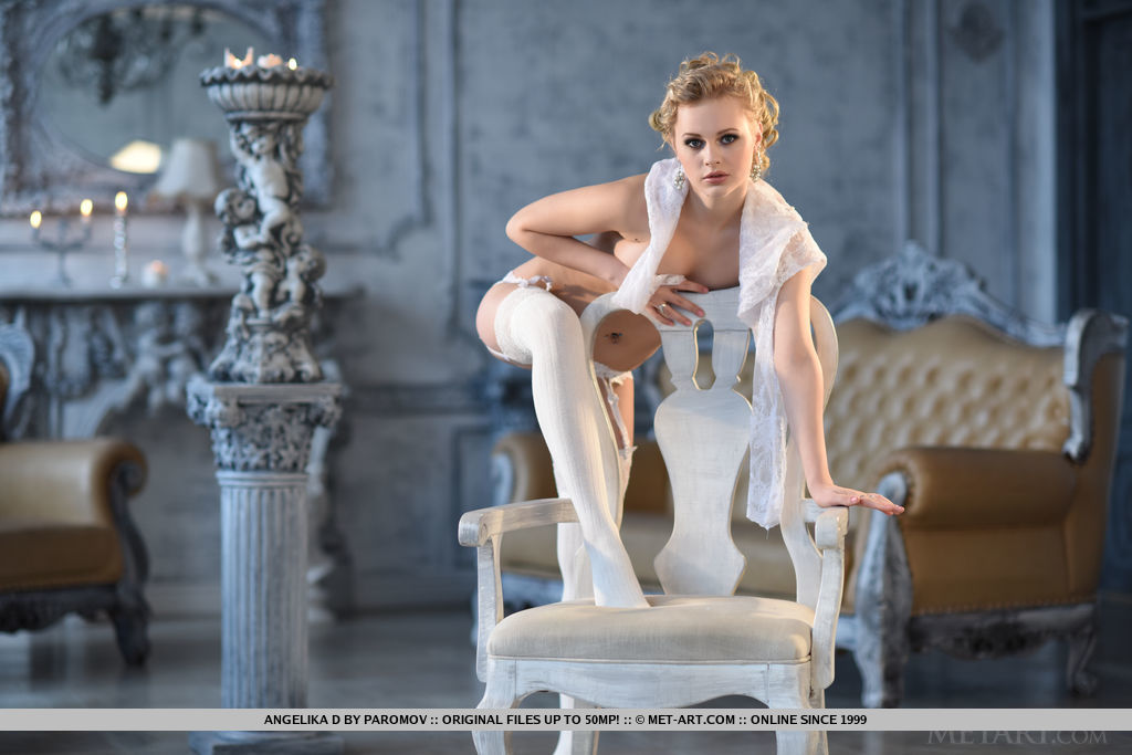 A budoir theme befitting a queen showcases Angelika D elegant feminine   features and alluring physique