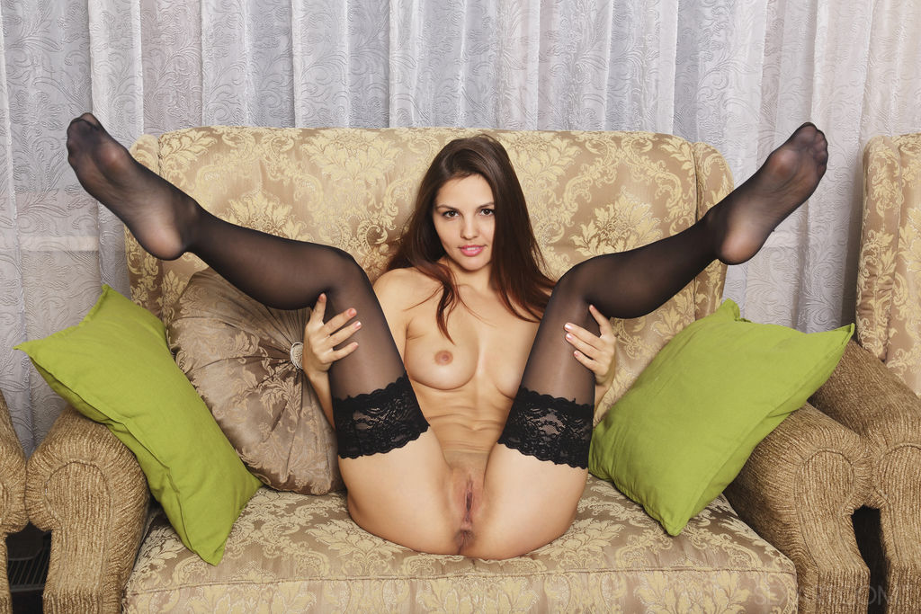 A seductive Alise Moreno strips off her matching lingerie and thigh high stockings