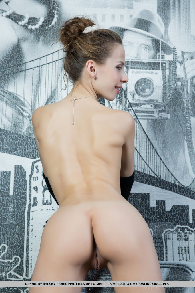 Dennie poses nothing but a pair of long, black golves that accentuates her petite figure and smooth, fair skin.