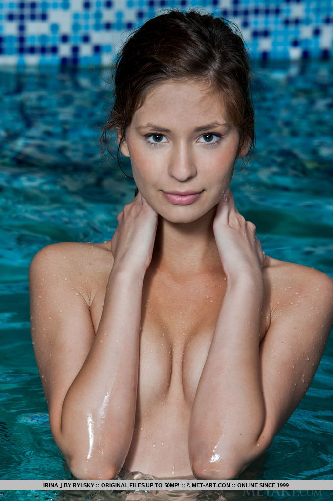 Irina J displays her petite, lean body, small breasts with perky nipples as she dips in to the pool.
