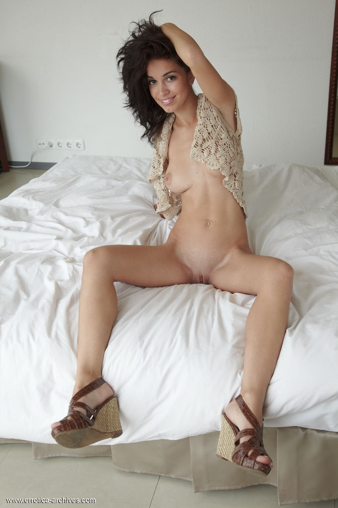 Karen shows off her amazing physique, round butt and yummy pussy as she poses on  the bed.