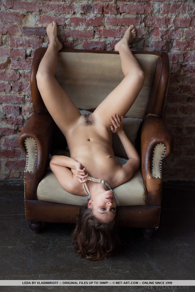 Leda's alluring beauty, slim and slender figure, tight butt and delectable pussy makes   a great view as poses on the chair.