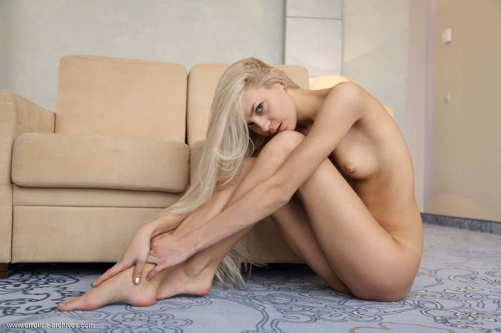 Leonie confidently prance around, naked flaunting her long, slender body with wide   open poses on the couch.