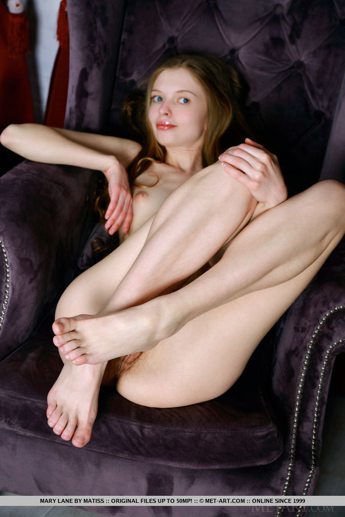 Mary Lane bares her creamy, white body and unshaven pussy on the chair.