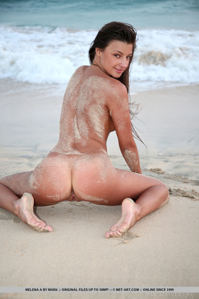 Melena A bares her sexy, tanned body as she sensually poses at the beach.