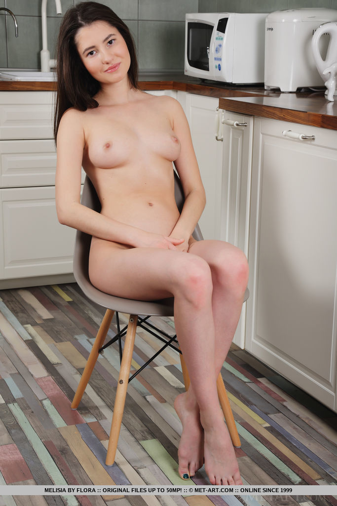 Newcomer Melisia strips in the kitchen as she displays her sweet, pink pussy.