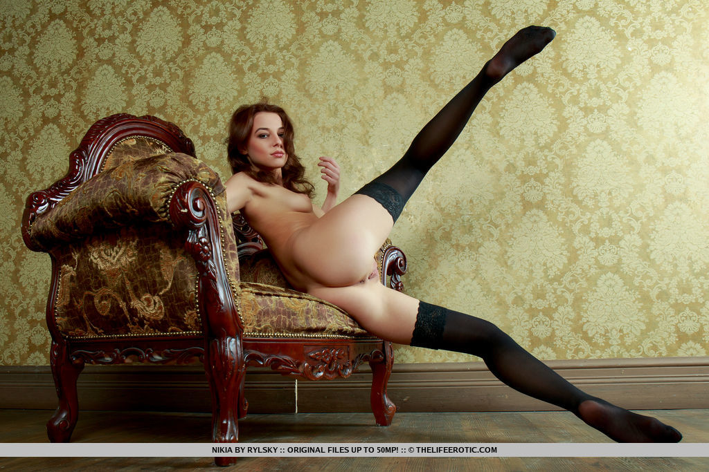 Nikia shows off her slender body and delectable pussy on the chair.