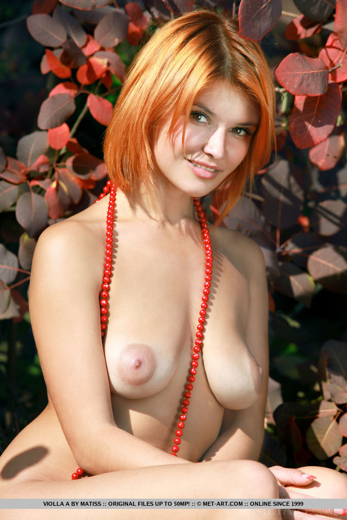 Redhead Violla A shows off her amazing body with puffy tits outdoors.