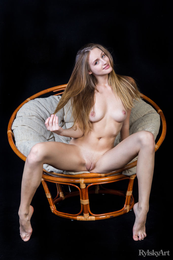 Violet bares her fully nude body and sweet pussy on the chair.