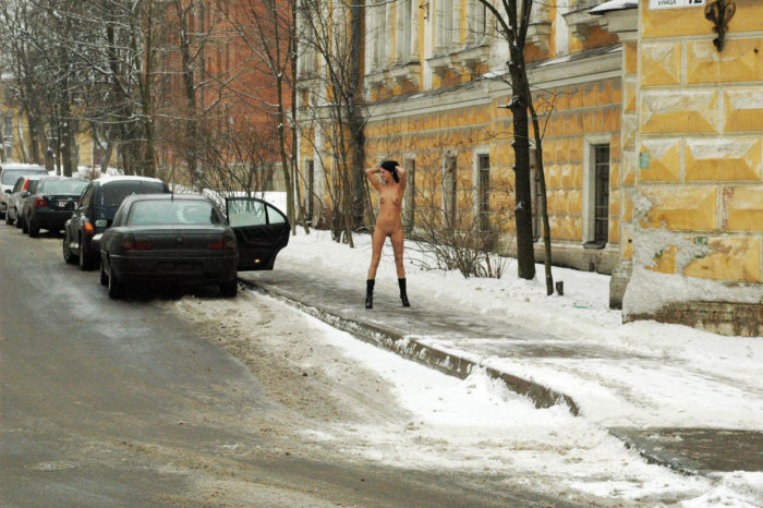 Russian amateur brunette Krista walks at winter streets with no clothes