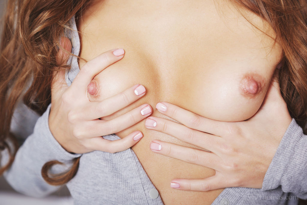 Sandy A shows off her perky nipples and shaved snatch