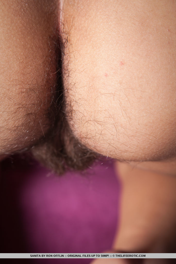 Sanita released her handcuffs as she rubs her hairy pussy.